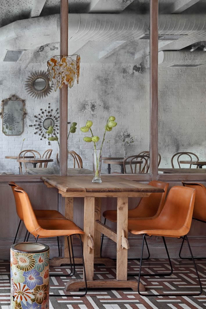 image of 4 natural leather chairs around a wooden rustic table