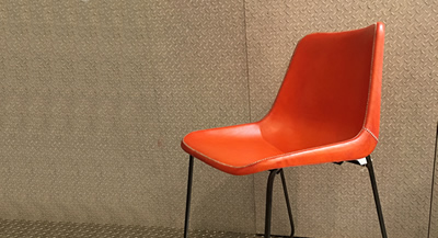 Image of a chair covered with the new leather color ORANGE from Sol&Luna