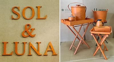 image of the sol and luna logo and differnt products covered with orange leather
