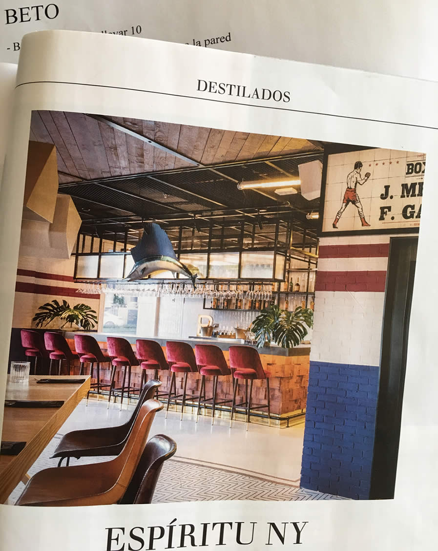 Image of a page from a magezine showing a bar and a dinner table with leather Sol&Luna chairs